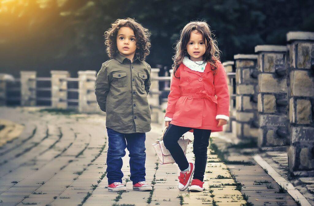 Fit bit Ace -7 Best kids fitness tracker 2 little friends standing