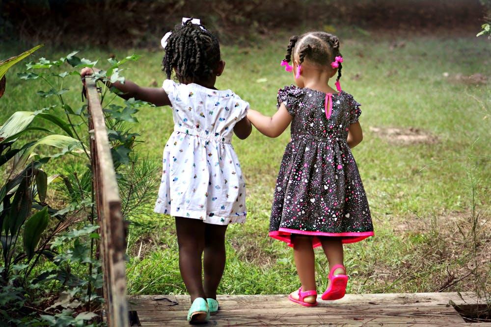 7 Best kids fitness tracker - 2 little girl friends walking around
