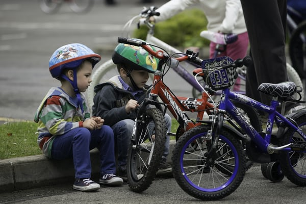 children playing with bicycles.